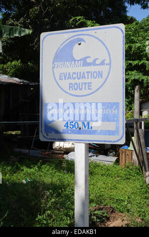 Sign showing Tsunami evacuation route, 450m, Thai Language. Koh Lanta, Ko lanta, Thailand, Southeast asia. - Stock Photo