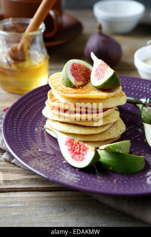Pancakes with figs and honey, food - Stock Photo