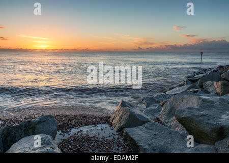 Sunrise over the beach at Sidmouth in Devon - Stock Photo