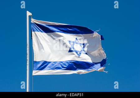 The Israelian flag waving in the wind - Stock Photo
