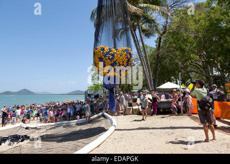 Rotary club is starting up the duck race in Palm Cove Australia - Stock Photo