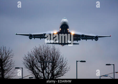 January 3rd 2015, Heathrow Airport, London. Low cloud and rain provide ideal conditions to observe wake vortexes - Stock Photo