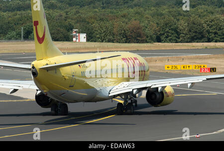 Tuifly Boeing 737 airliner taxiing to runway at Dusseldorf International airport in Germany - Stock Photo