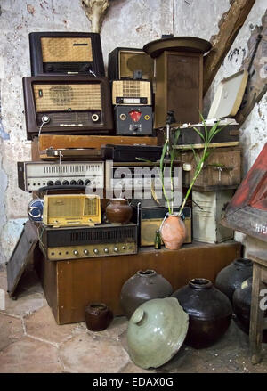old radios in a heap - Stock Photo