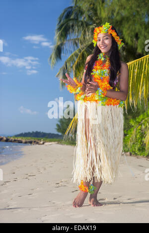 Hula Hawaii dancer dancing on the beach - Stock Photo