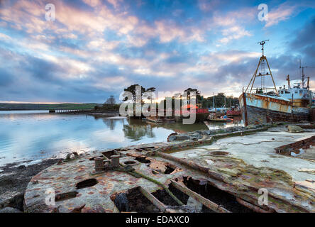 Old abandoned rusting boats in a boat graveyard on the river Tamar in Cornwall - Stock Photo
