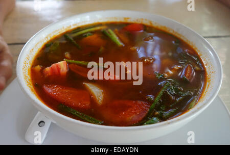 Tom yum or tom yam soup served in a ceramic bowl, Thailand, Asia. - Stock Photo