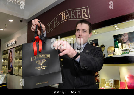 Male man shop sales assistant at T. H. Baker Jewellers jewellery shop uk - Stock Photo