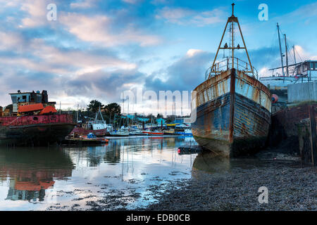 Rusting old boats on the river Tamar in Cornwall - Stock Photo