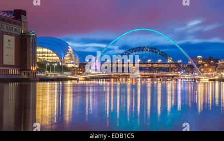 View down the river Tyne towards landmark bridges at dusk. The Baltic and The Sage (left). Newcastle upon Tyne, - Stock Photo