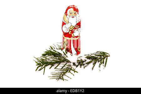Chocolate Santa Claus in snow - Stock Photo