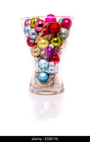 Christmas baubles with lights in a vase - Stock Photo