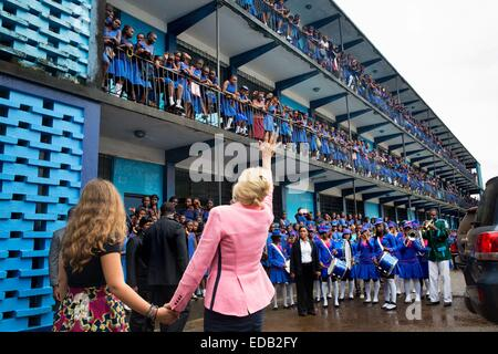 Dr. Jill Biden, wife of the Vice President, and granddaughter Finnegan Biden wave to students assembled on the railings - Stock Photo