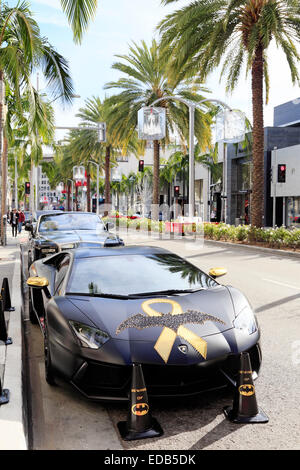 Batman decorated Lamborghini parked on Rodeo drive, Beverly Hills, Los Angeles, California. - Stock Photo
