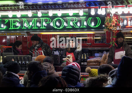 people in line to buy sandwiches from a truck bar - Stock Photo