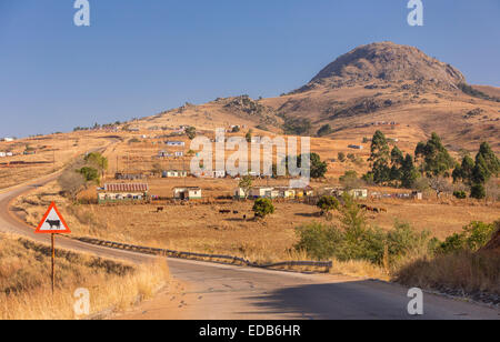 HHOHHO, SWAZILAND, AFRICA - Rural settlement, homes, buildings and farming and paved highway. - Stock Photo