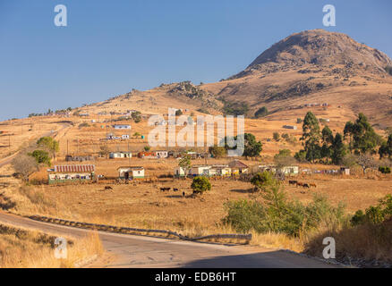 HHOHHO, SWAZILAND, AFRICA - Rural settlement, homes, buildings and farming and paved road. - Stock Photo
