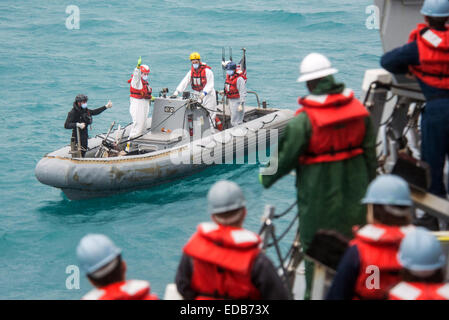 US Navy sailors from the from the Arleigh Burke-class destroyer USS Sampson during search and recovery operations - Stock Photo