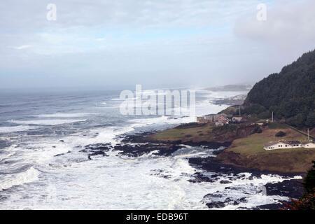 Stormy seas pound into the Devil's Churn and Cape Perpetua' coastline south of Yachats along the scenic Oregon Coast - Stock Photo