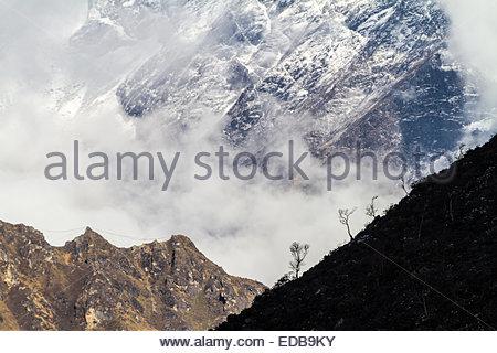View of snowcapped Himalaya mountain during trek - Khumbu Region - Nepal - Stock Photo