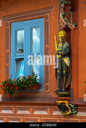 Wooden statue of a German emperor with crown, scepter and the globus cruciger at the Guild hall Kaiserworth, Goslar, - Stock Photo