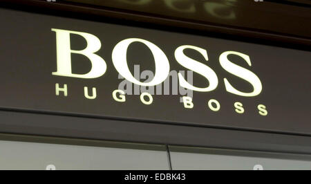 Picture shows the Hugo Boss logo above a store entrance. - Stock Photo