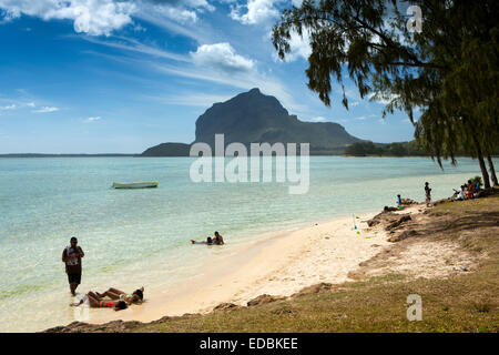 xMauritius, Le Morne, weekend, family relaxing on small empty beach beside sheltered lagoon - Stock Photo