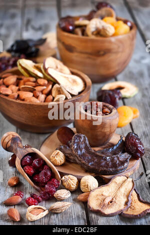 Mix of dried fruits and almonds - symbols of judaic holiday Tu Bishvat. - Stock Photo