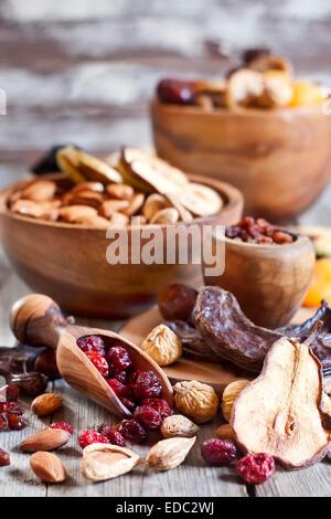 Mix of dried fruits and almonds - symbols of judaic holiday Tu Bishvat. - Stock Photo