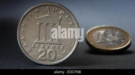 Wuerzburg, Germany. 03rd Nov, 2011. ILLUSTRATION - A Greek 20 drachm coin and a one-euro coin are pictured in Wuerzburg, - Stock Photo