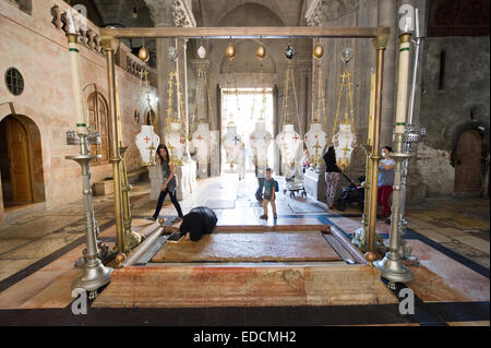 The stone of the Anointing at the Church of the Holy Sepulchre. Also known as 'The Stone of Unction - Stock Photo