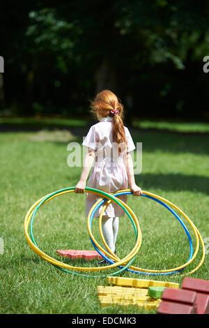 gymnastic girl with hula hoop