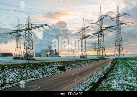 Power lines & Coal fired power station in winter, Germany.