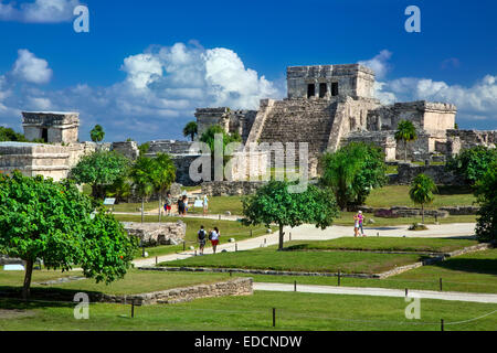 Tourists visiting the ruins of the Mayan temple grounds at Tulum, Quintana Roo, Yucatan, Mexico - Stock Photo