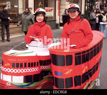 Two ladies promote Hong Kong in London's Chinatown during the Chinese New Year celebrations. - Stock Photo