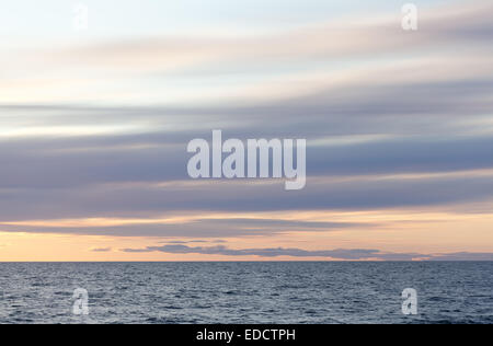 Stratus clouds over the sea - Stock Photo