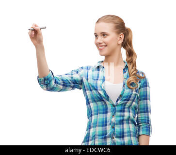 smiling young woman writing on virtual screen - Stock Photo