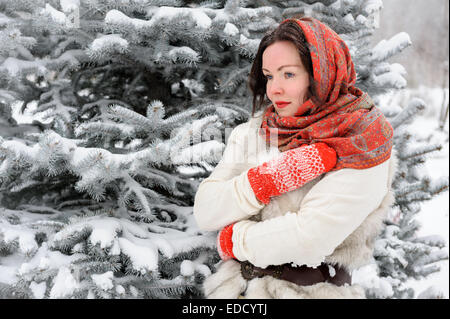 Young Russian woman in winter park - Stock Photo