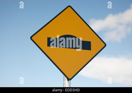 warning sign bump in road, Ireland - Stock Photo