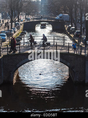 Amsterdam Reguliersgracht Canal famous for it's seven bridges. Bicycles on the bridges and along the canal on a - Stock Photo