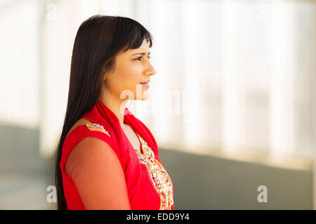 thoughtful Indian businesswoman wearing saree in office - Stock Photo