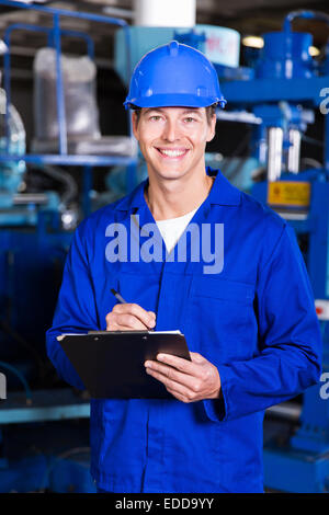 handsome factory manager in production area - Stock Photo