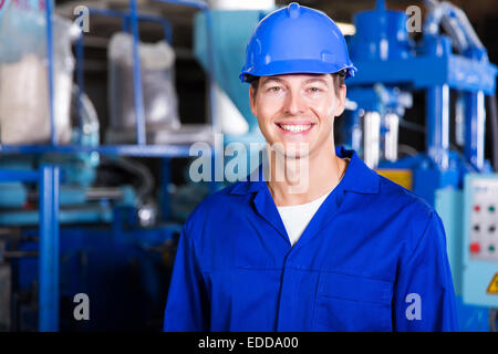 handsome male factory technician looking at the camera - Stock Photo