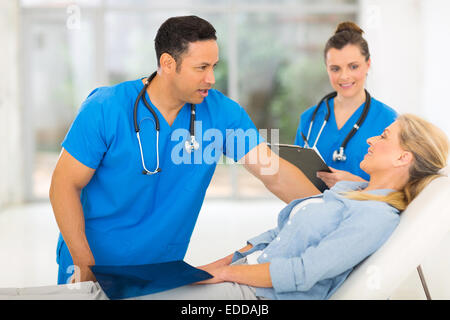 beautiful senior woman in doctor's office for check up - Stock Photo