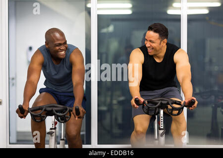 cheerful men working out in gym - Stock Photo