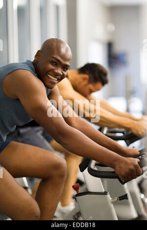 fit African man working out in gym - Stock Photo