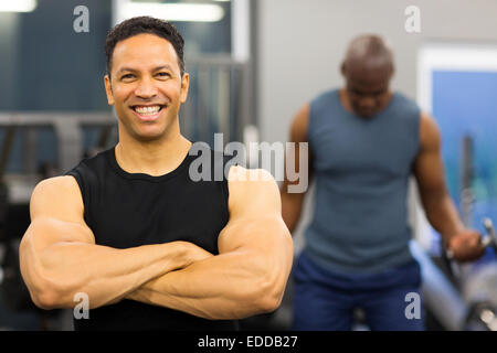close up portrait of bodybuilder with arms crossed - Stock Photo