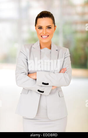 portrait of young businesswoman standing in modern office - Stock Photo