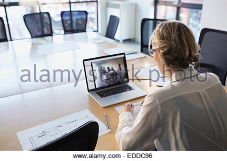 Businesswoman video conferencing on laptop - Stock Photo