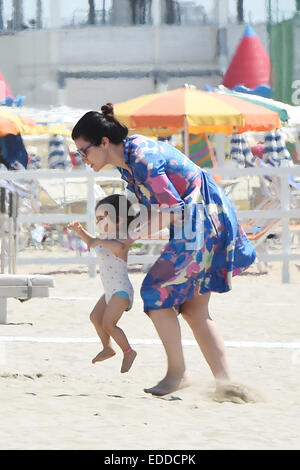 Italian pop singer and record producer Laura Pausini enjoys a day on the beach with her daughter Paola and family - Stock Photo